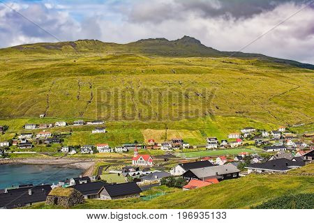 Sandavágur (Strandbugten) is a village on the southern part of the island of Vágar, the Faroe Islands. Sandavágur lies, as the name suggests, at the end of a bay with a sandy beach