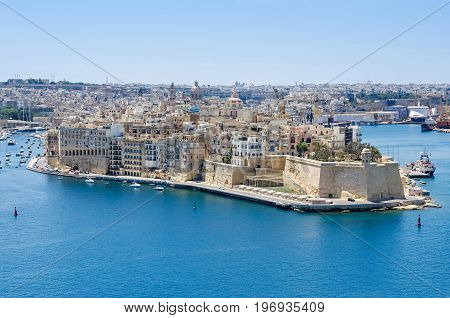 Senglea peninsula as seen from the Upper Barrakka Gardens with its waterfront the St.Philip's Chapel dome bastions of Fort Saint Michael and buildings inside of defensive walls