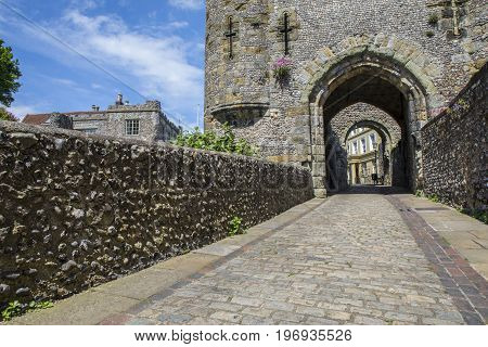 Looking through the historic Barbican Gate at Lewes Castle in the town of Lewes in East Sussex UK.