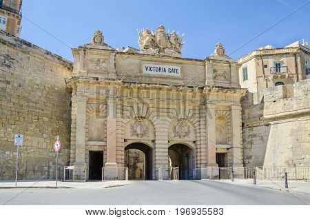 Victoria Gate the former main entrance into the city from the Grand Harbour area with the walls of St. Barbara Bastion in Valletta Malta