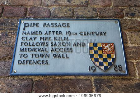 LEWES UK - MAY 31ST 2017: A plaque at Pipe Passage in the historic town of Lewes in East Sussex UK on 31st May 2017.