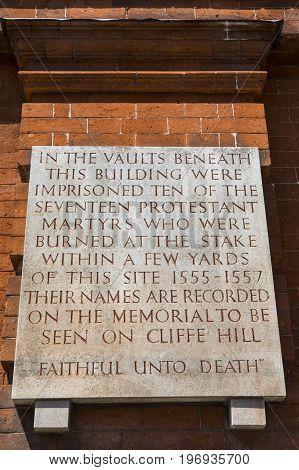 LEWES UK - MAY 31ST 2017: Plaque on the exterior of County Hall in Lewes detailing the history of the vaults beneath the building on 31st May 2017.