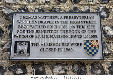 LEWES UK - MAY 31ST 2017: A plaque noting the history of a house on the historic Keere Street in Lewes East Sussex UK on 31st May 2017.