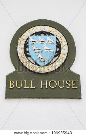 LEWES UK - MAY 31ST 2017: A plaque at Bull House in the town of Lewes East Sussex UK. Bull House is HQ of the Sussex Archaeological Society on 31st May 2017.