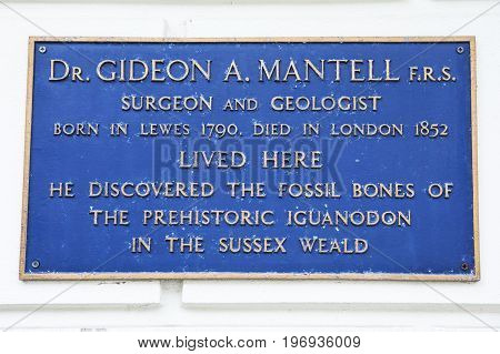 LEWES UK - MAY 31ST 2017: A plaque marking the location where Dr. Gideon A. Mantell lived in Lewes East Sussex on 31st May 2017. He discovered the fossil bones of the prehistoric Iguanodon.