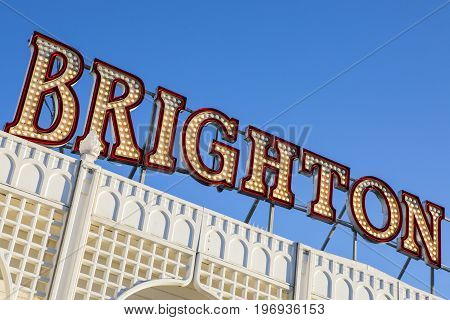 BRIGHTON UK - MAY 31ST 2017: Brighton in lights on the historic Brighton Pier in East Sussex UK on 31st May 2017.