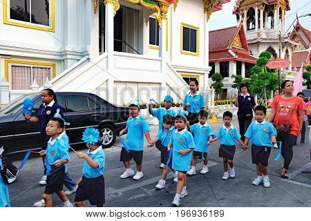 Bangkok, Thailand - January 8, 2016: Pupils of the Elementary School of Wat Chana Songkhram during festive procession through the streets of the city. A festive and beautifully dressed Thai children