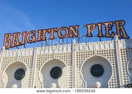 BRIGHTON UK - MAY 31ST 2017: The lit-up neon sign on the historic Brighton Pier in East Sussex UK on 31st May 2017.