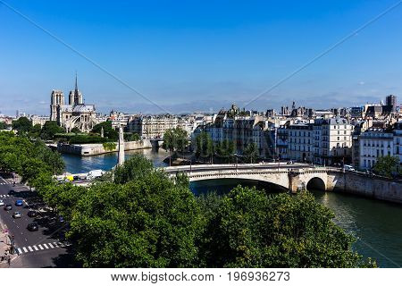 Panorama of Paris: Cité Island with Notre Dame de Paris Cathedral and Saint Louis Island on the Seine river. Notre Dame cathedral is a medieval catholic cathedral and finest example of french gothic architecture. France.