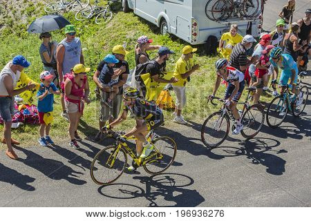 Col du Grand ColombierFrance - July 17 2016: Thomas Voeckler of Direct Energie TeamStef Clement of Team IAM and Tanel Kangert of Team Astana riding in a hairpin curve at Col du Grand Colombier in Jura Mountains during the stage 15 of Tour de France 2016.
