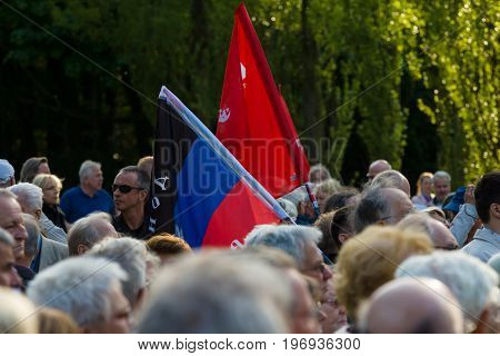 BERLIN - MAY 08 2015: Victory in Europe Day. Treptower Park. Participants of commemorative events with the flags of the German Communist Union and the People's Republic of Donetsk.