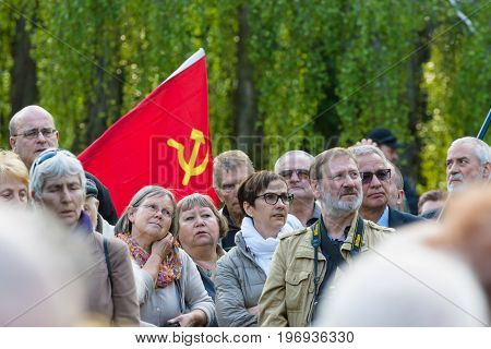 BERLIN - MAY 08 2015: Victory in Europe Day. Treptower Park. Participants of commemorative events with the flags of the Soviet Union