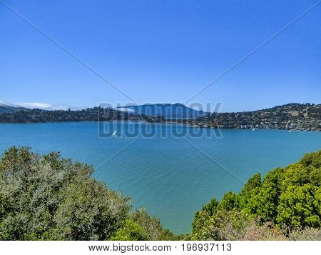 Skyline Of Angel Island In San Francisco With Sailboat And Houses