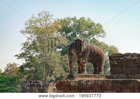 Two-meter-high stone elephant statue on the walls of the East Mebon temple in Angkor Complex, Siem Reap, Cambodia. Ancient Khmer architecture, famous Cambodian landmark, World Heritage