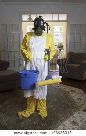 Mature Woman In Haz Mat Suit With Blue Bucket And Mop