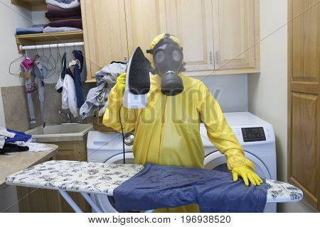 Mature Woman In Haz Mat Suit Ironing Shirt On Board