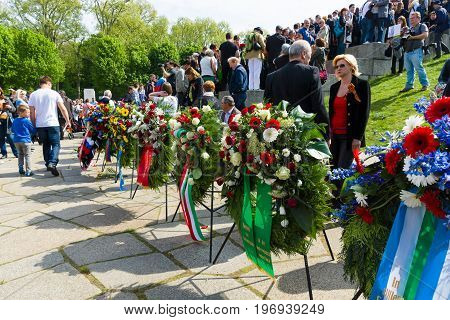 BERLIN - MAY 09, 2015: Wreaths at the foot of the monument from the embassies of different countries.