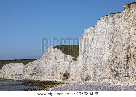 The view from Birling Gap of the Seven Sisters white chalk cliffs in East Sussex UK.
