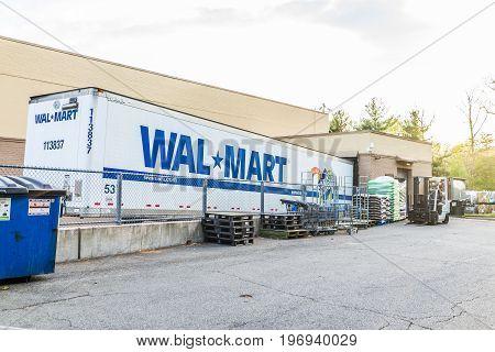 Burke, Usa - April 16, 2017: Parked Long Walmart Truck Unloading At Store Building
