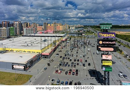 Tyumen, Russia - June 13, 2017: Aerial view onto Zeleniy Bereg shopping center and European residential district