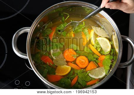 Woman preparing brine for turkey in cooking pot