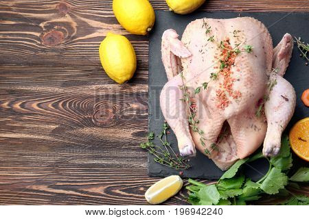 Composition with whole raw turkey and some products on slate plate