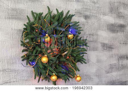 Beautiful trendy Christmas wreath on light background
