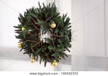 Beautiful trendy Christmas wreath on window