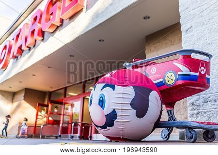 Fairfax, Usa - May 9, 2017: Mario Face On Target Ball With Shopping Cart And Signs Of Game For Ninte
