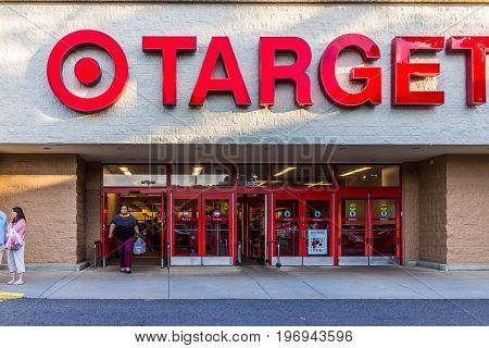 Fairfax, Usa - May 9, 2017: Target Store Entrance With Woman Walking Out With Sign
