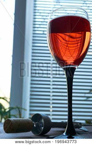 Low Key Shot Of Wineglass Of Red Pink Wine