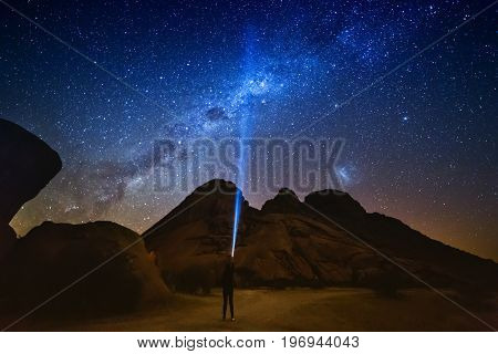 Star-catcher. A Person Is Standing Next To The Milky Way Galaxy Pointing On A Bright Star. The Summe