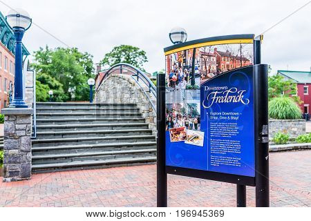 Frederick, Usa - May 24, 2017: Carroll Creek In Maryland City Park With Sign And Red Brick Area