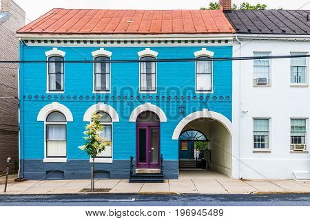Frederick, Usa - May 24, 2017: Bright Blue House In Downtown Maryland City With Brick Architecture A