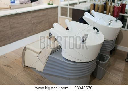 The Interior Of A Spa Salon. Chair For Washing Hair