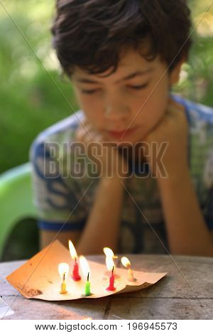 Teenager Mischievous Boy Play With Candles Burn Fire