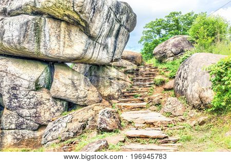 Trail Leading To Devil's Den In Gettysburg Battlefield National Park With Rock Boulders During Summe