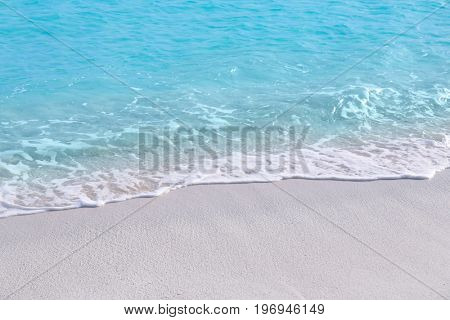 Warm sand and sea waves on beach at resort