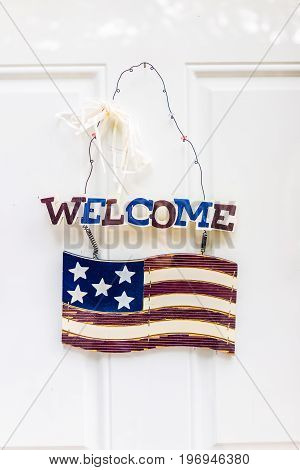 Welcome door hanging sign with American Flag and red white and blue patriotic colors