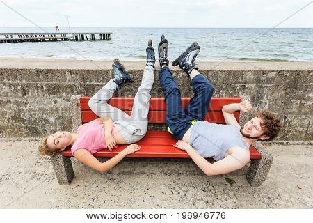 Young Tired People Friends Relaxing On Bench.