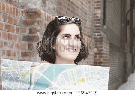 Young Tourist Woman Looking At A Map.