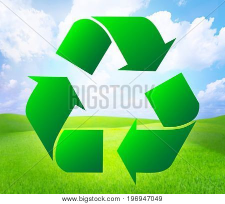 Sign of recycling on landscape background. Ecology and environment conservation