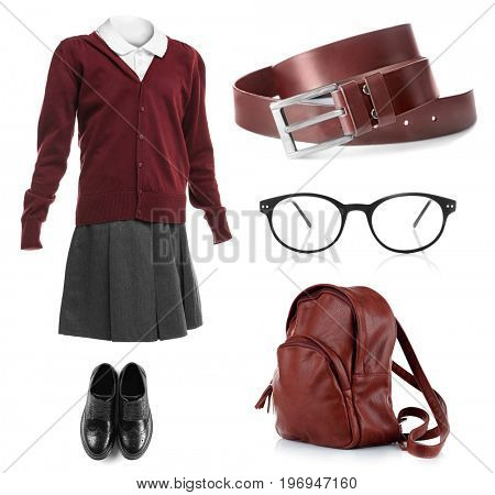 Set of school uniform with accessories for girl on white background