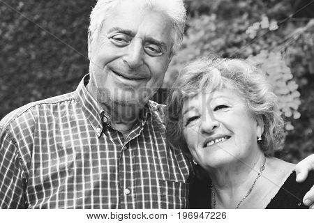 An Elderly Couple Outdoors.