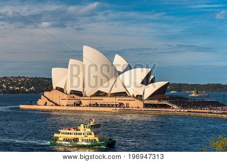 Sydney Opera House And Ferry Boat In Sydney Harbour