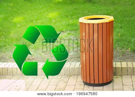 Sign of recycling and litter bin in park. Ecology and environment conservation