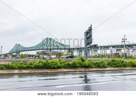 Montreal, Canada - May 25, 2017: Jacques Cartier Bridge During Rainy Cloudy Day In Quebec Region Cit