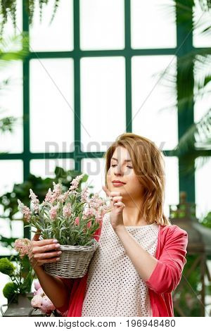 Happy florist at green house