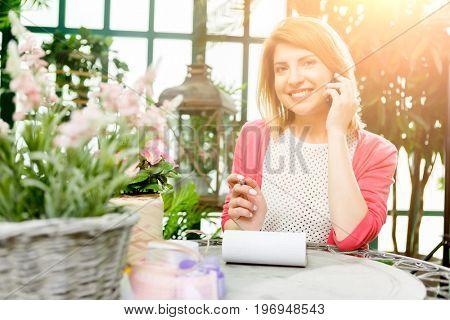 Beautiful florist in flower shop