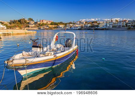 Fishing boats on the coastline of Kato Galatas town on Crete, Greece